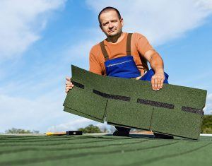 Man Holding a Shingle